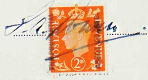 George VI postage stamp used to show payment of purchase tax with the signature of the recipient across it.