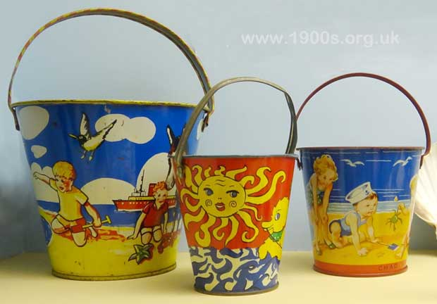 Children's decorated metal buckets for playing in the sand, 1930s