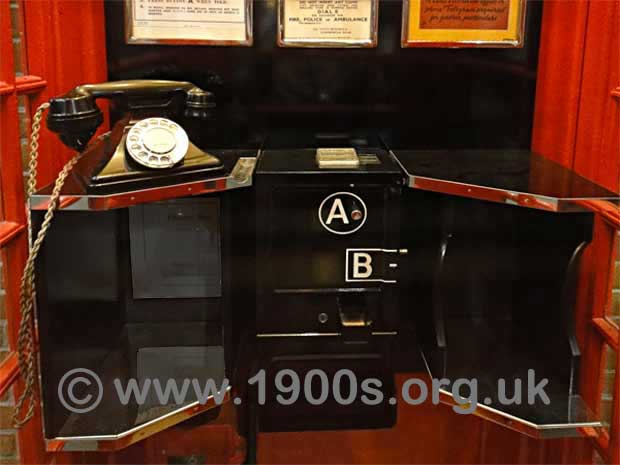Inside a 1940s / 1950s UK public phone box showing the arrangement of the telephone, the coin slots, button A and button B.