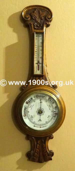 Wall mounted aneroid barometer in carved wooden case