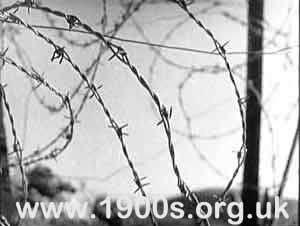 "Barbed wire beach defences, World War Two, England preventing anyone from going beyond them into the seam 2 of 2"">"