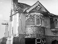 A bombed out house in 1940s war-time Britain