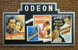 Billboard advertising several films from the 1940s, thumbnail
