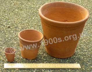 Three clay pots of increasing size from the 1940s.  		The smallest, known as a 'thumbs' was for very young seedlings
