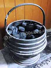 Coal scuttle for storing coal beside a fireplace, commonly used with a coal fire.
