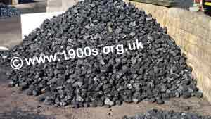 Coal in a heap in a coal yard.