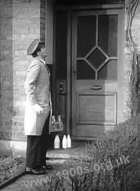 Milkman delivering milk to a home, 1940s-1950s England.