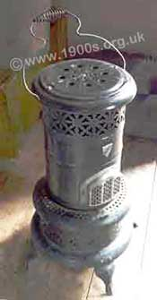 Common form of paraffin heater / oil stove in the mid 20th century - British