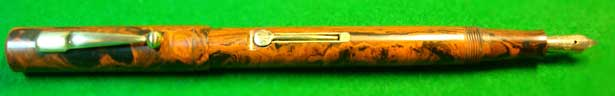 Old lever-style fountain pen ready for use