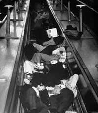 People sleeping on London Underground escalators to shelter from bombs in WW2