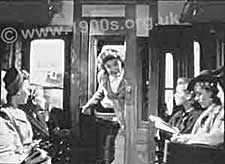 A train compartment, 1940s, showing its door to the corridor open