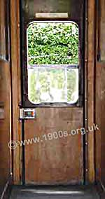 Inside of a train door as common in Britain in the 1940s and 1950s showing its very stiff inside latch