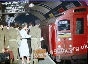 Army personnel on London Underground platforms during WW2