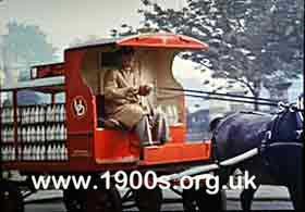 Horse-drawn 1940s United Dairies (UD) milk float 1 of 2