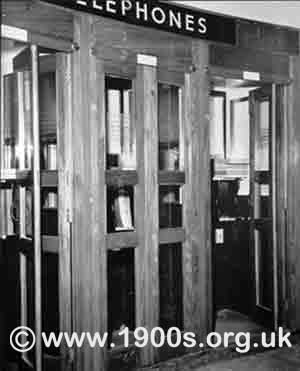 Wooden booths of public telephones as found in stations and other public places in 1940s abd 1950s Britain