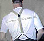 Back view of a man wearing braces