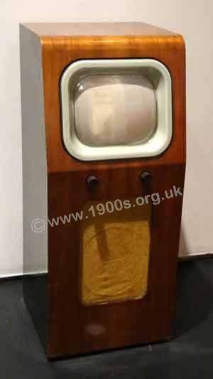 vintage television in polished wood cabinet