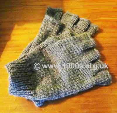 Vintage knitted gloves without fingers for tradesmen handling money