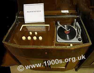 Radiogram, mid-1900ss, with lid open to show the radio and the gramophone.