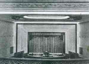 Cinema stage with curtains across the screen