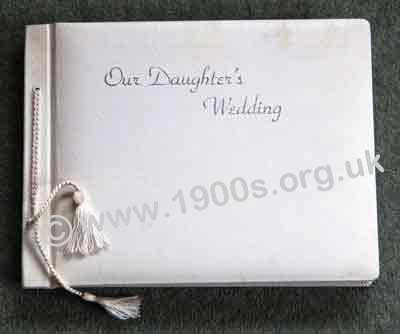 Wedding photo album, professionally produced, mid 20th century: bound in white leather cover embossed in silver with �Our Daughter�s Wedding