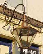 Typical old gas lamp, as hung outside public houses in the UK