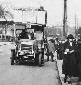 Old open top bus and trolley bus in Fore Street, Edmonton, in the early 1900s