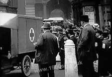 Convoy of ambulances leaving a London station transporting wounded WW1 soldiers to the military hospitals. The red cross is clearly shown on the front of the nearest ambulance