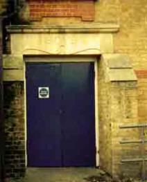 Typical early 1900s school entrance for boys leading from their own playground to the top floor