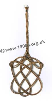 old carpet beater for beating the dust out of carpets - common in the early 1900s