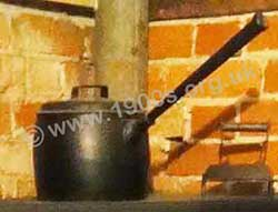 Cast iron saucepan showing its long handle