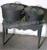 oid cast iron cooking pots on a cast iron trivet.