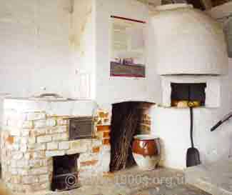 The arrangement in the outhouse at Jane Austen's house in Chawton, whereby the old copper, an old fireplace and an old bread oven all use the same chimney.