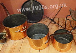 Highly polished copper saucepans