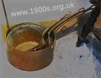 Tarnished copper saucepans