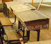 Classroom desks, common in Victorian times to the 1960s, with plank-style wooden seats attached