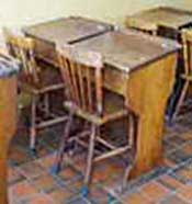 Classroom desks, common in Victorian times to the 1960s, for use with chairs rather than the attached plank-style wooden seats