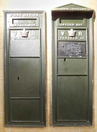 Two examples of green Victorian post boxes