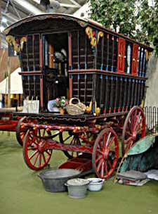 A restored gypsy caravan in Milestones Museum, Basingstoke, showing its typical bright colours