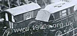 Gypsy caravans - detail from an early 1900s photograph of a gypsy camp.