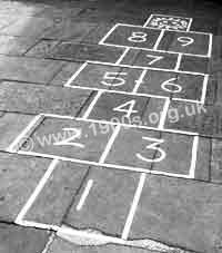 Paving slabs marked out for Hopscotch