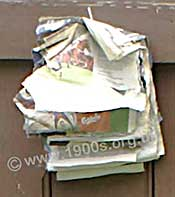 Squares of newspaper on a string, to serve as toilet paper in the early 1900s and before