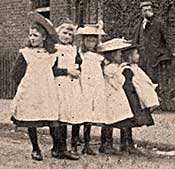Girls wearing the white pinafores, standard dress, early 1900s