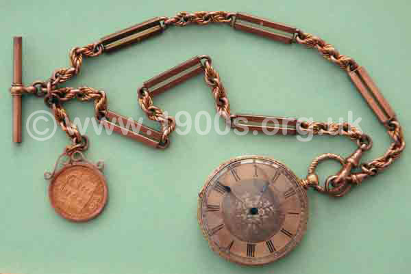 Man's gold pocket watch on gold chain