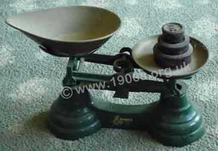 Early 1900s scales suitably shaped for tipping out goods into a much smaller receptacle.