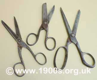 Victorian or Edwardian everyday scissors, blackened and blunted with age and use because they were made of steel which was not stainless.