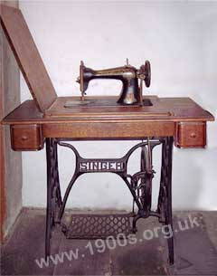 an old treadle type of sewing machine, typical of the late 1800s and early 1900s.