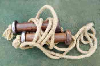 Early 1900s superior skipping rope with wooden handles containing ball bearings to prevent the rope from twisting out of shape as it swung round