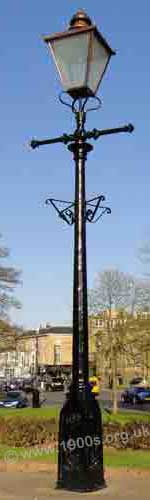 Old gas street lamp showing the bars for the lamplighter's ladder to lean against