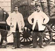 Men who drove the coal delivery carts in the first half of the 20th century, showing their summer dress code of white coats